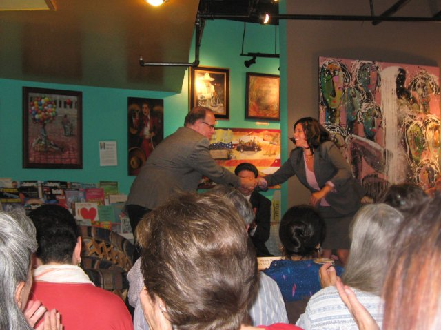 Larry Mantle shaking hands with Councilwoman Michelle Martinez at Libreria Martinez, Santa Ana